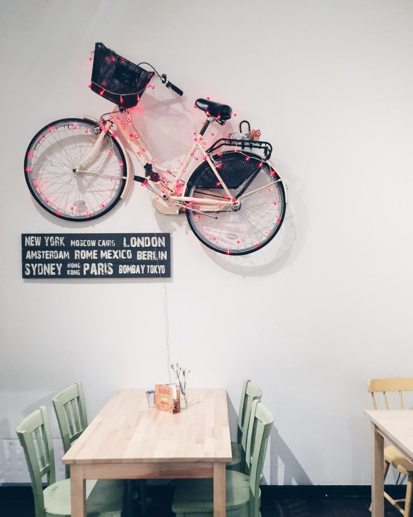 bicycle on wall in cafe