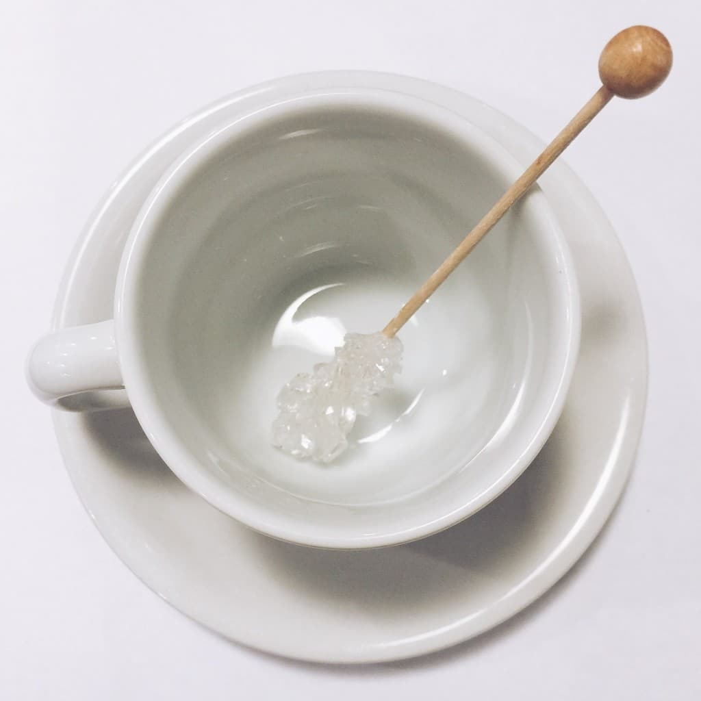 sugar on a stick in a cup