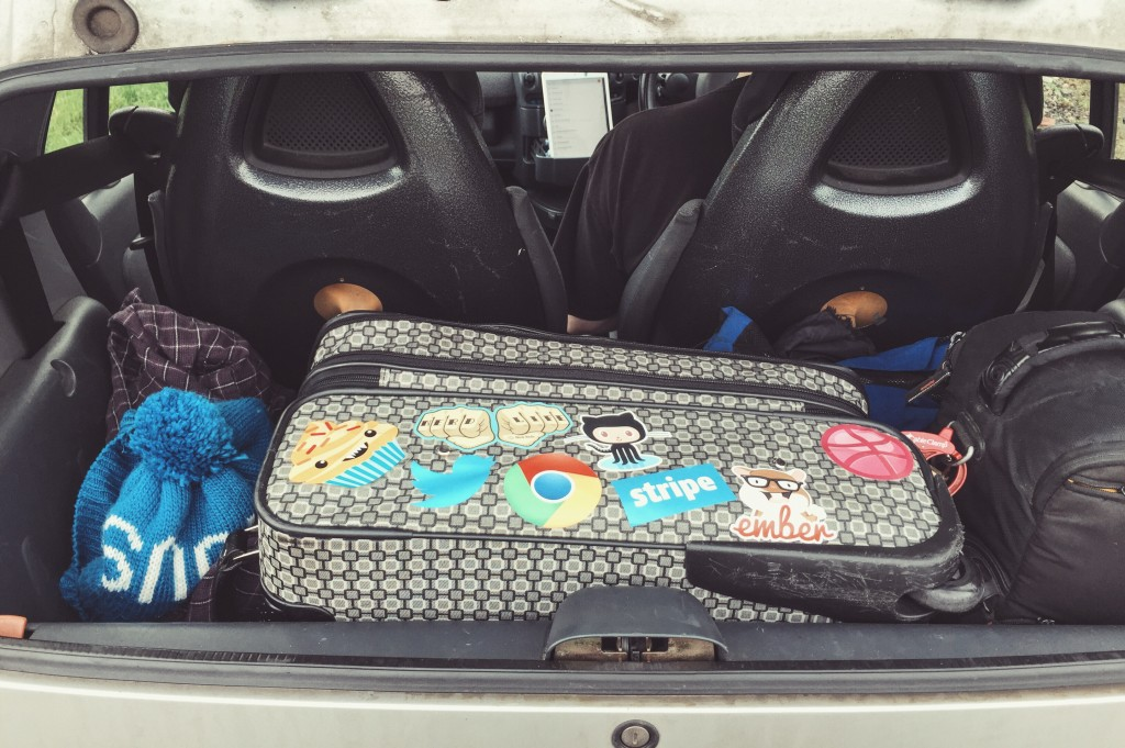 bags packed road trip smart car