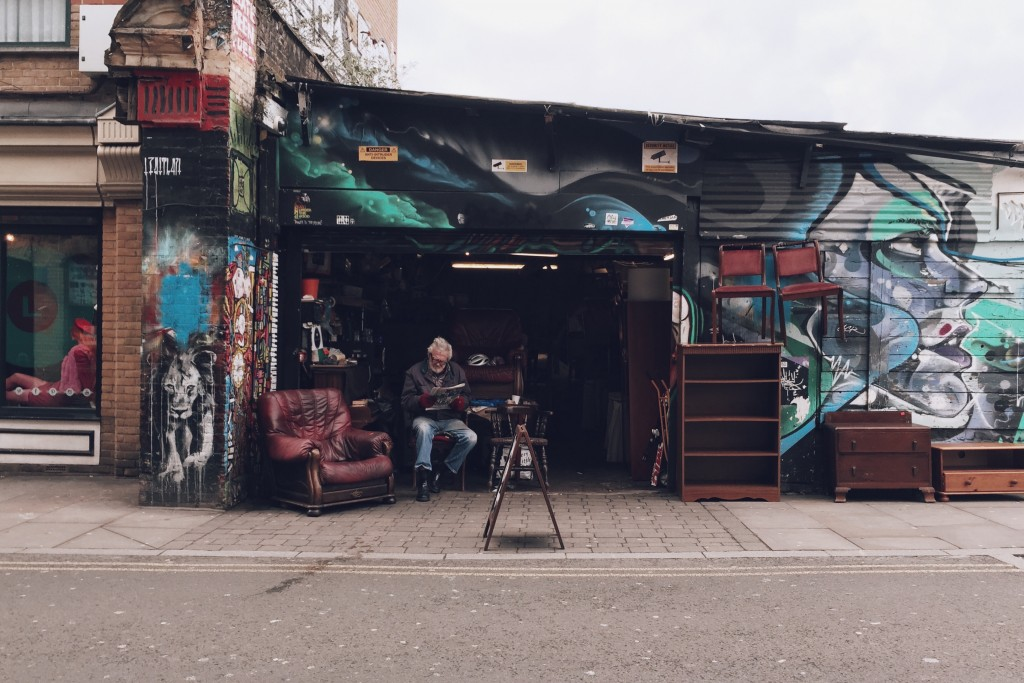 man sitting outside in a shop