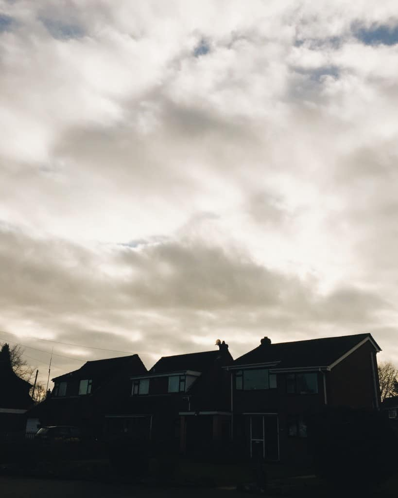 stormy clouds houses
