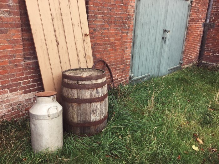wood barrel in grass