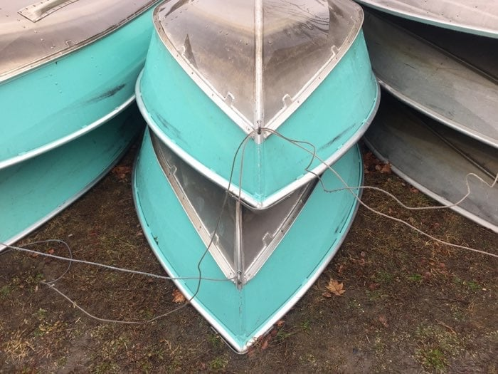 blue row boats stacked