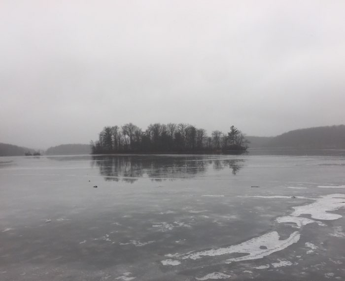 island on icy lake